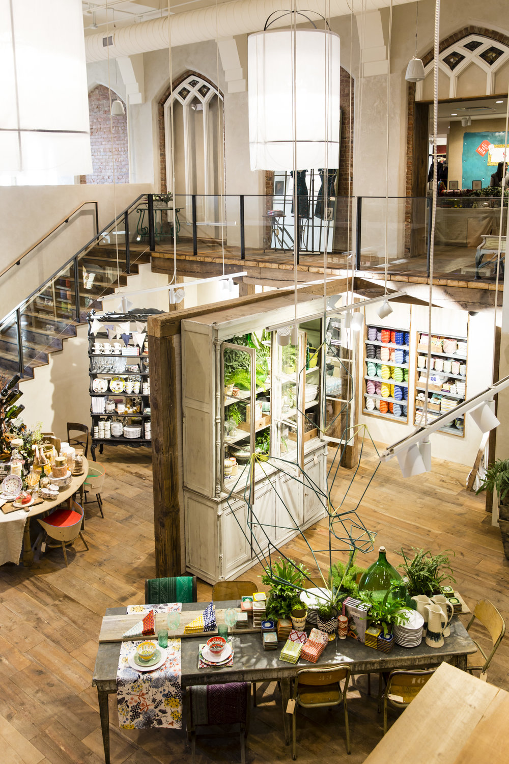 Adaptive reuse of a church preserves Gothic arches in the Anthropologie store in Toronto, created in collaboration with NewStudio Collaboration