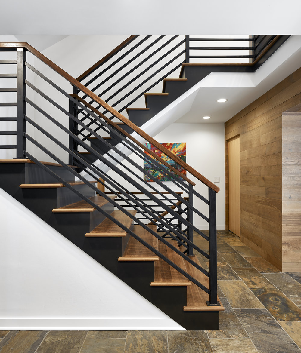 Dramatic steel and wood staircase, designed by NewStudio Architecture