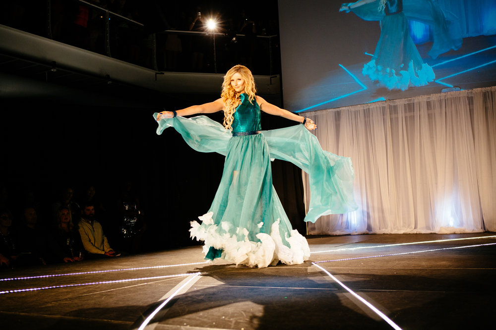 NewStudio Architecture's entry featured a flowing cape and wave-inspired hemline for the IIDA Fusion + Fashion runway show