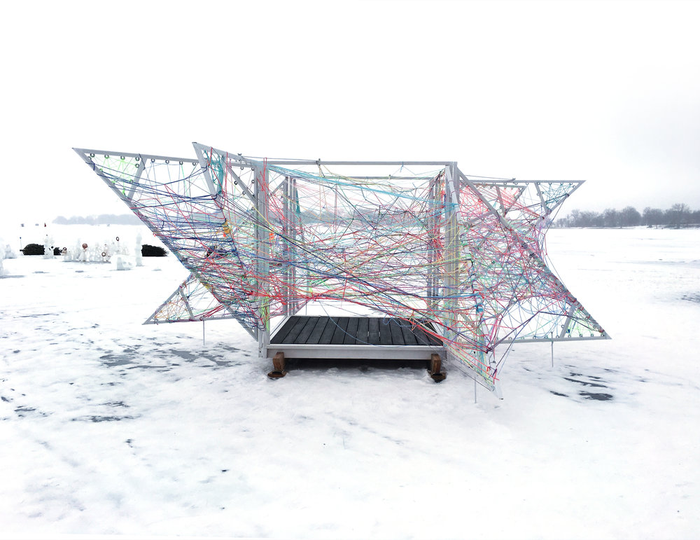 NewStudio Architecture designed the String Box Shanty to encourage visitors to thread string on the white-painted steel structure