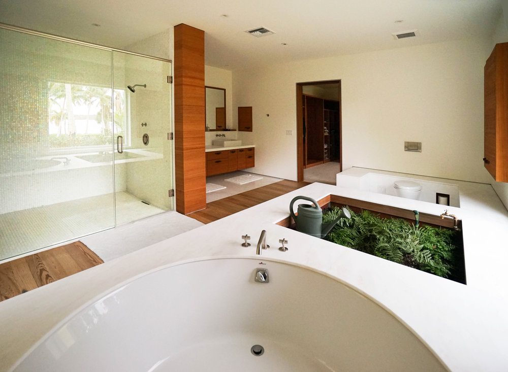 Gardener's sink incorporated into bathroom interior design by NewStudio Architecture