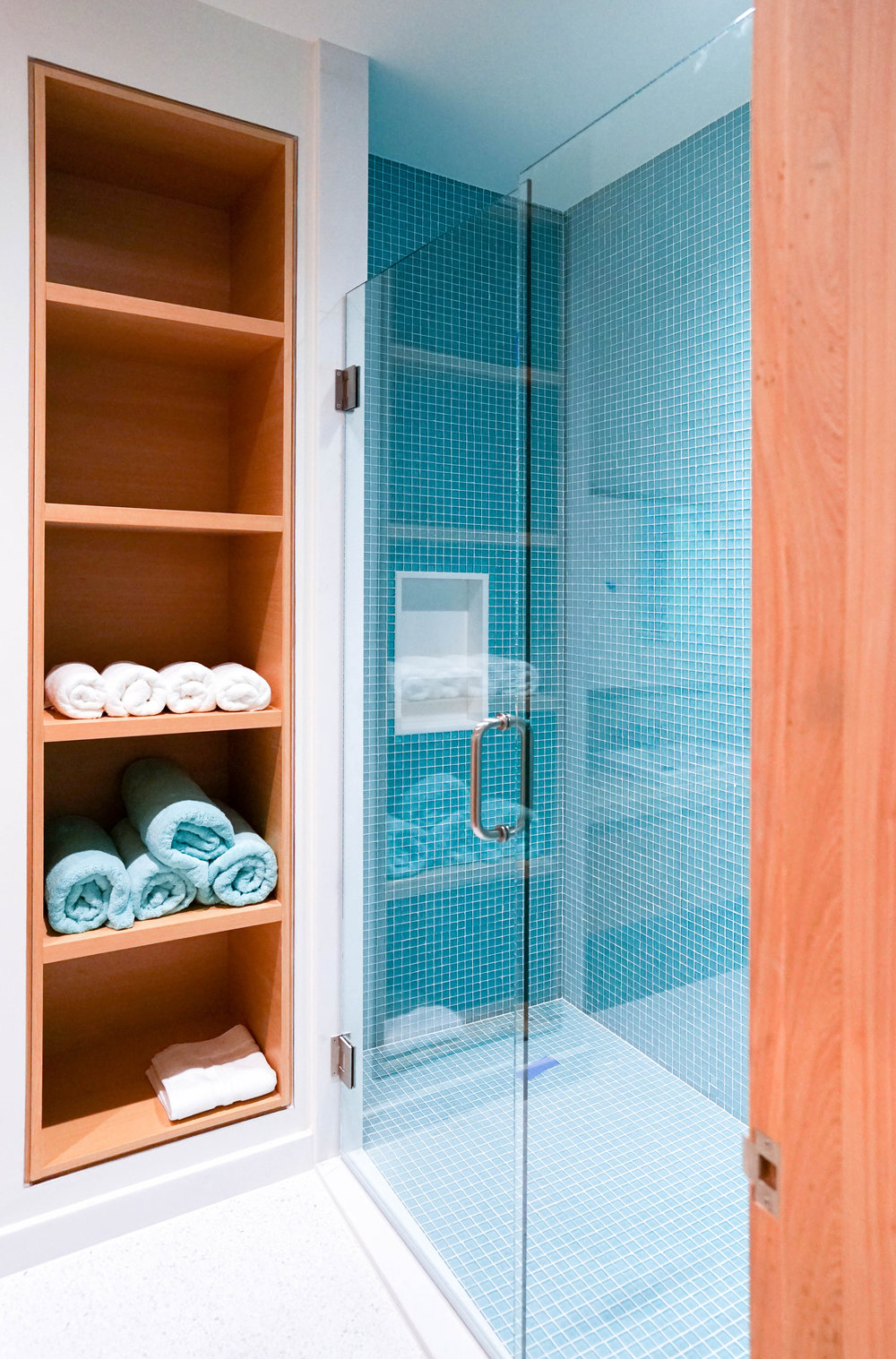 Aqua tile shower designed by NewStudio Architecture