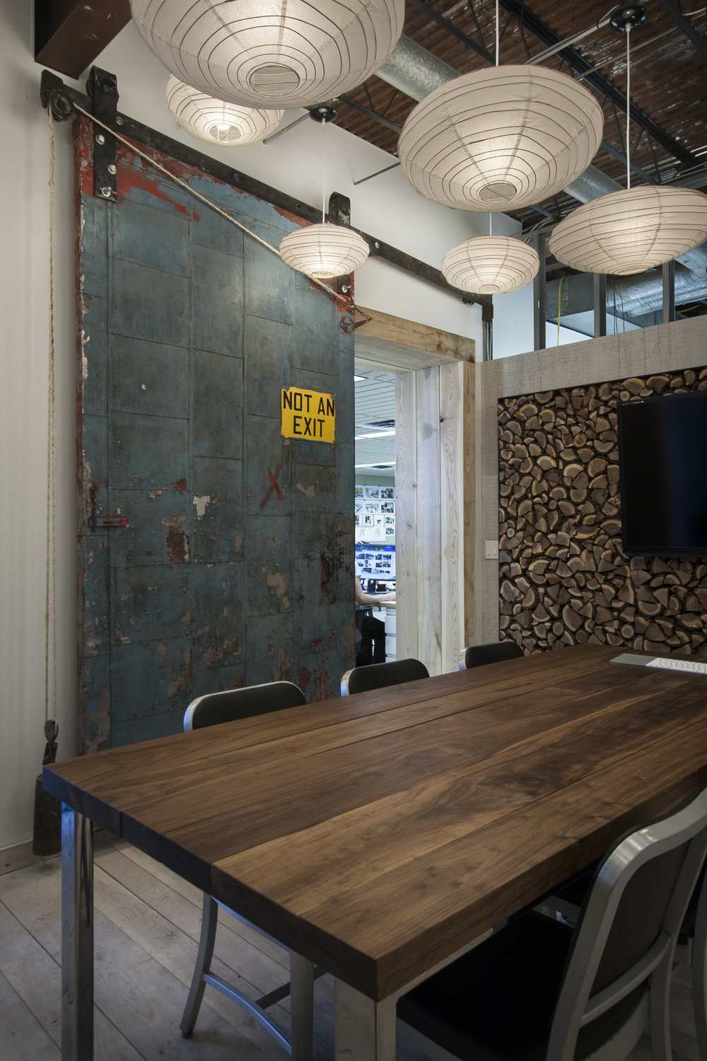 Meeting space with reclaimed door at NewStudio Architecture's original office