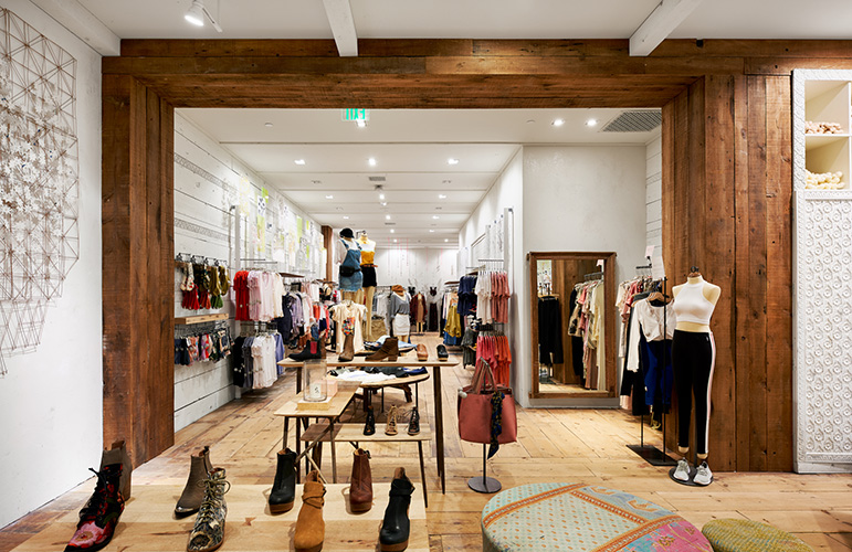 Spacious interior of Free People in MOA, created in collaboration with NewStudio Architecture