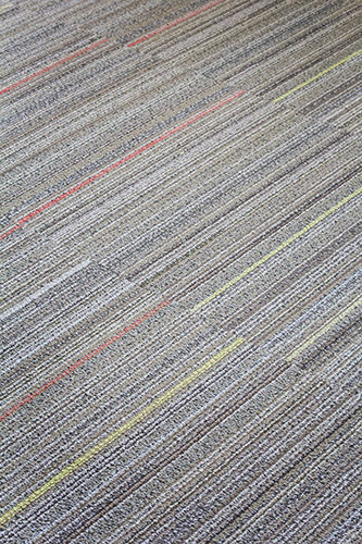 NewStudio Architecture chose colored-striped carpet panels for Johnson Turner Legal offices