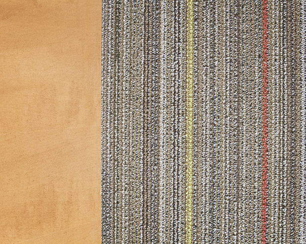 Wood accents and striped carpeting add texture to the office space's interior design created by NewStudio Architecture