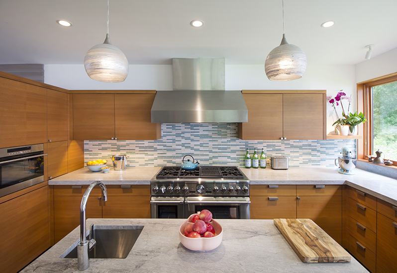 Center island in sleek mid-century modern kitchen designed by NewStudio Architecture