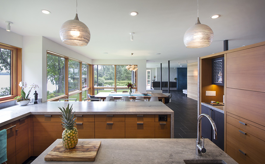 Natural light floods the kitchen and dining area, designed by NewStudio Architecture
