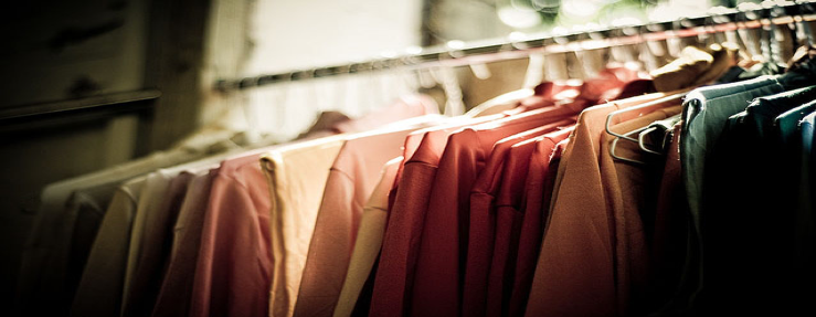 Clothing hanging on a garment rack.