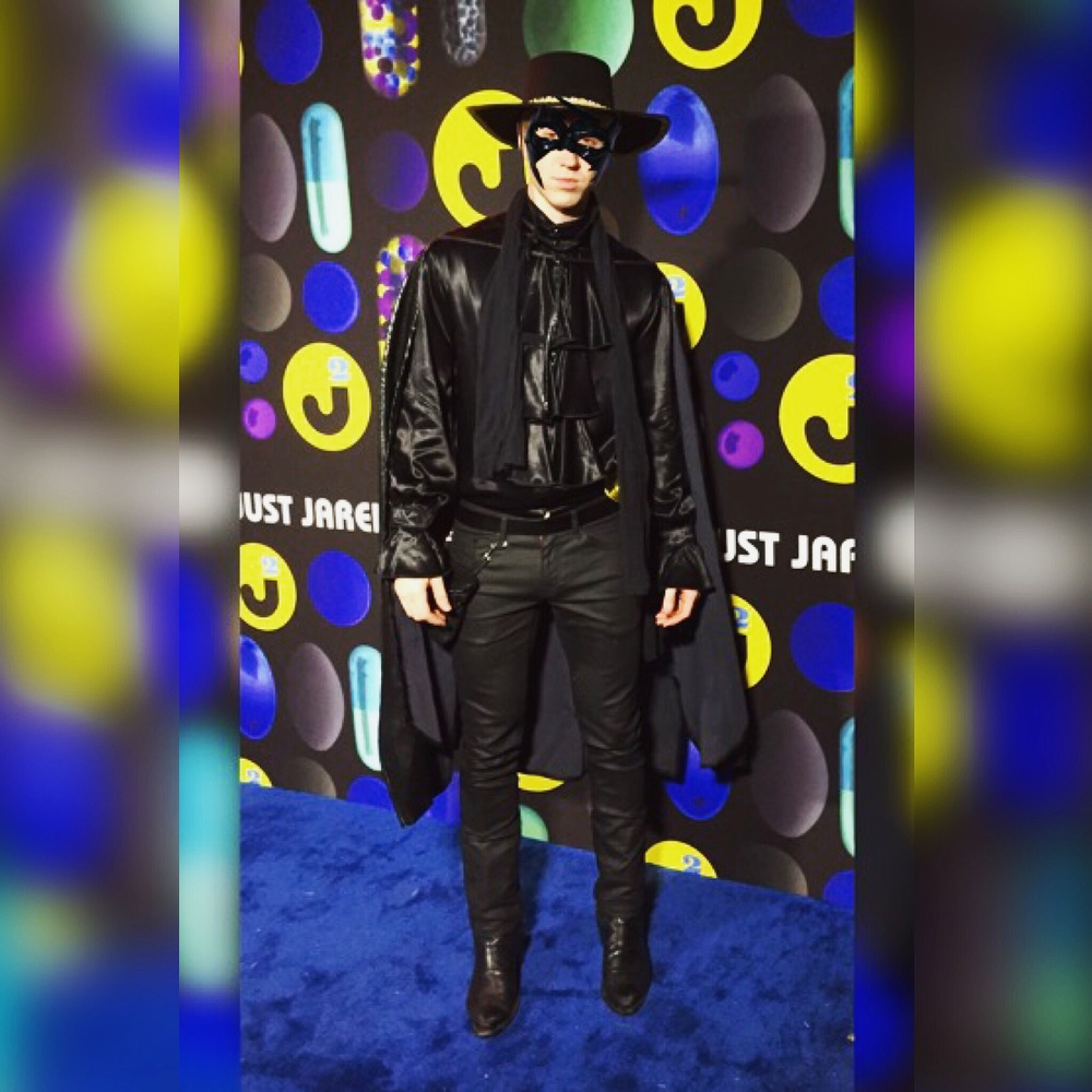 Jon Asher on the blue carpet, attending Just Jared Halloween bash on October 31, 2015