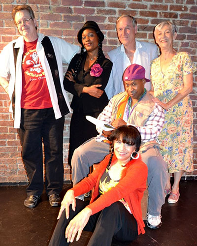 Travis Holder (left) and the cast of the play.