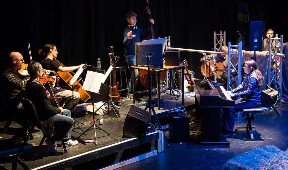 Steven Smith (centre) conducts the band for  Spring Awakening: The Musical  at The Meteor in 2016.
