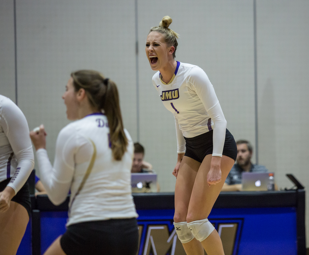 Janey Goodman celebrating after JMU receives a point against the College of Charleston.