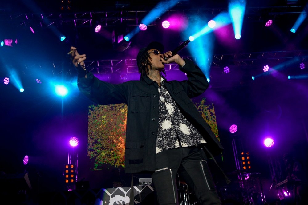 Wiz Khalifa performing Saturday night at Thrival Music, with Khalifa Kush in hand.