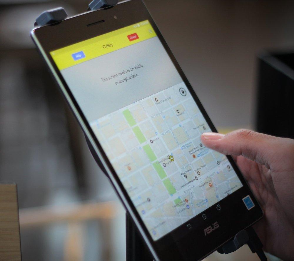 FlyBuy Restaurant tablet tracking customer for mobile order pickup
