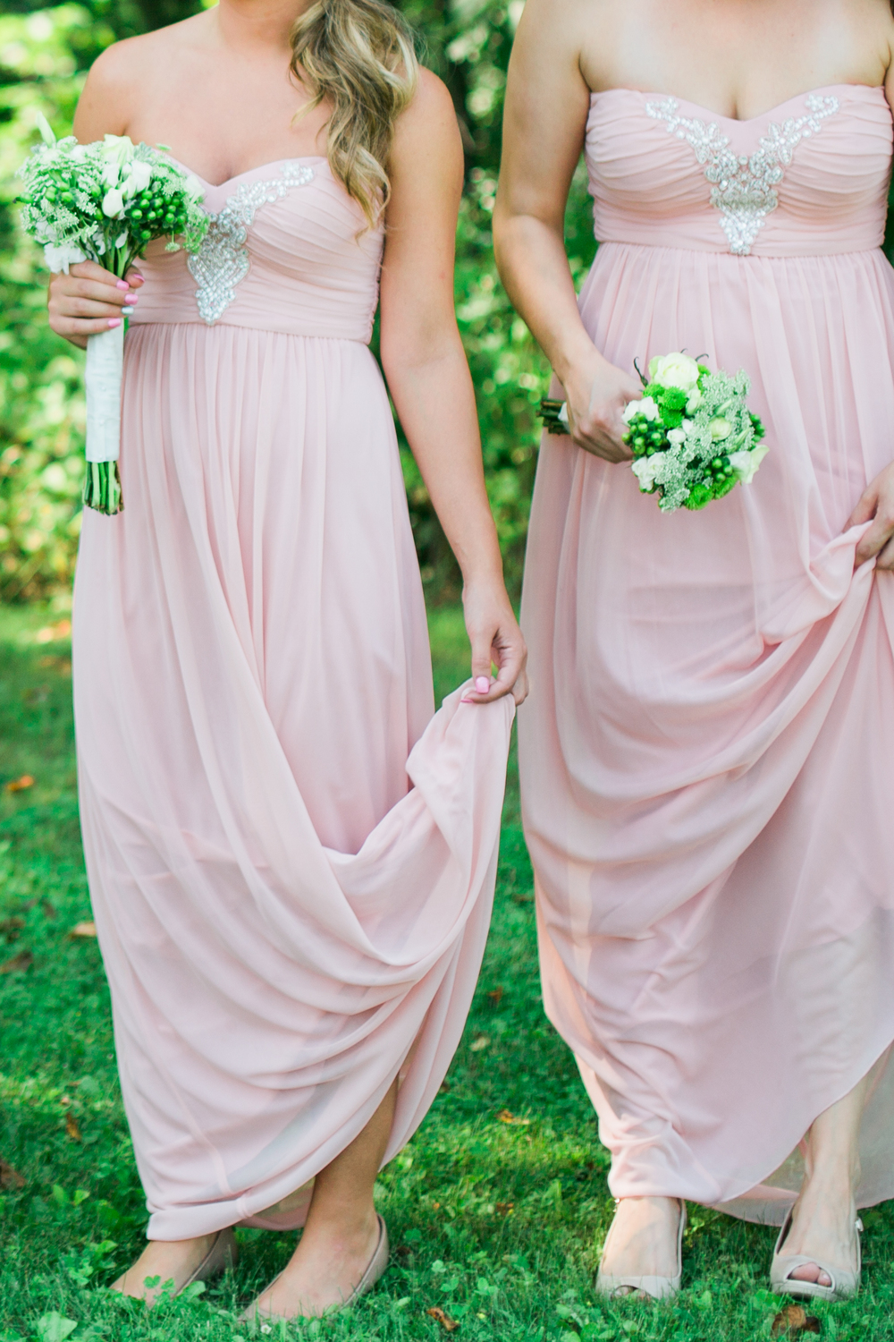 Blush bridesmaid dresses and minimalist bouquets for wedding at Echo Valley in Wisconsin