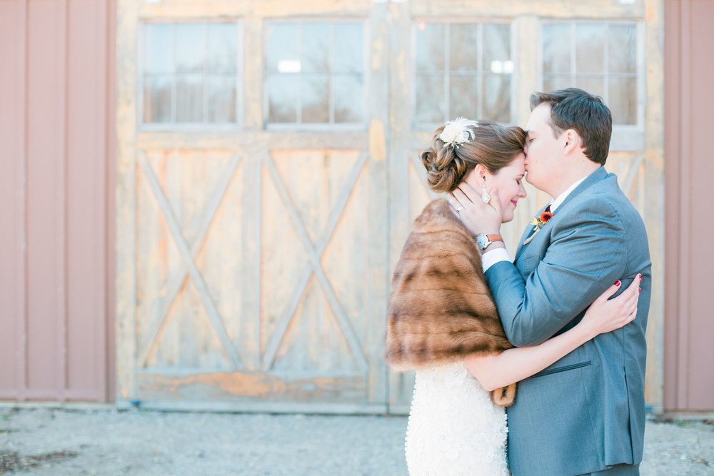 Bride and groom forehead kiss at Edgewood Farm in Henderson Minnesota