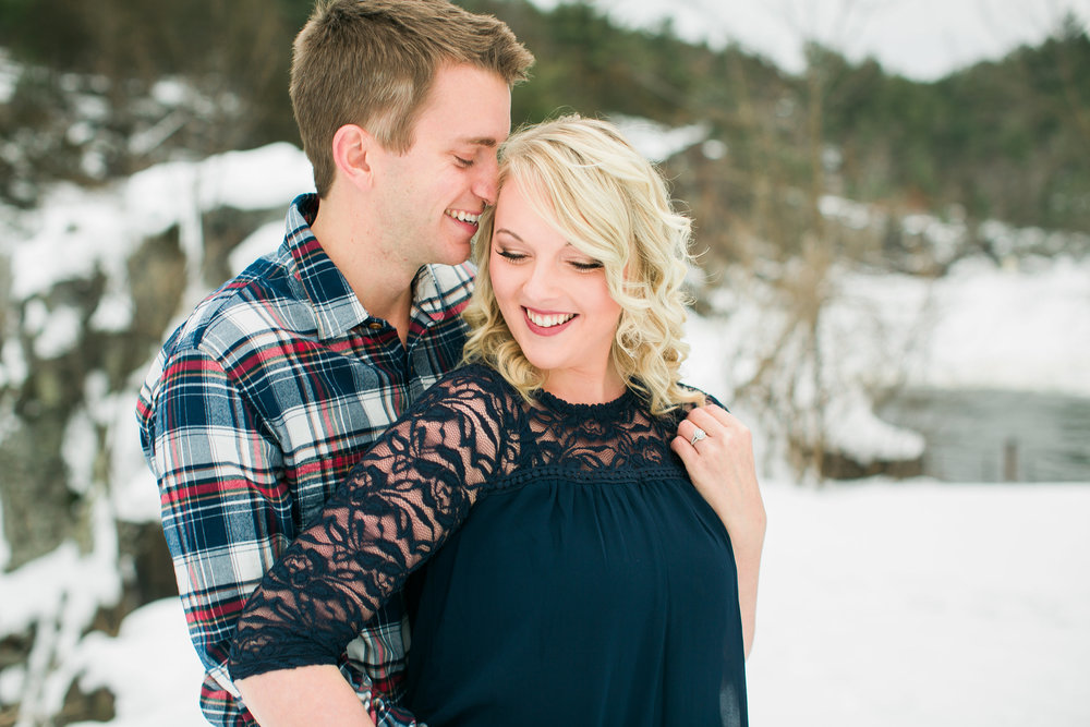 Snowy engagement photos in Taylors Falls Minnesota with bride and groom