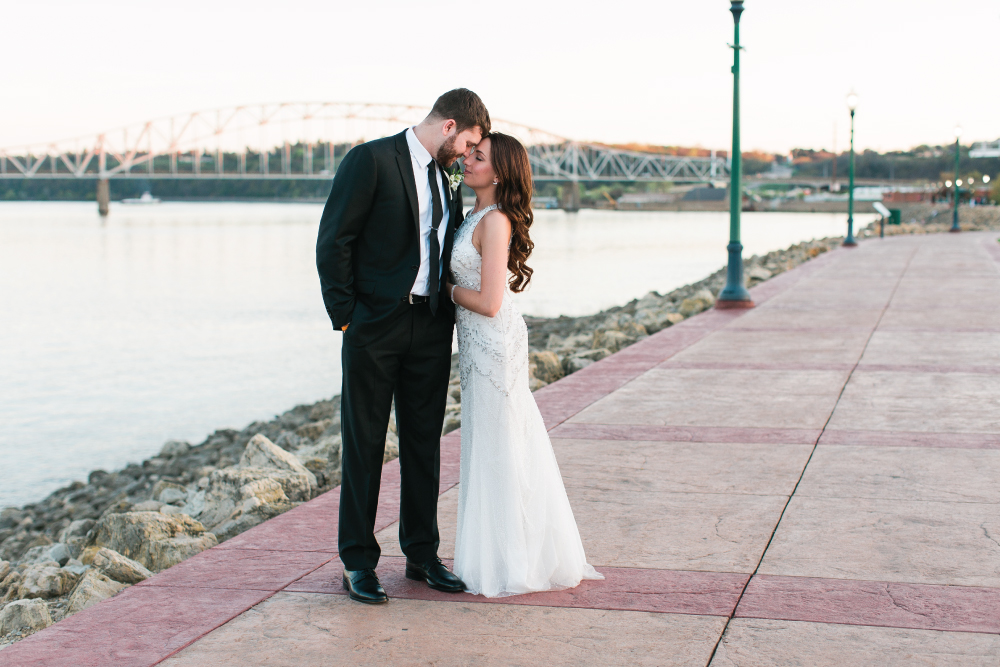 Dubuque IA River Center Wedding, modern beaded wedding gown and black suit. Photographed by Mallory Kiesow.