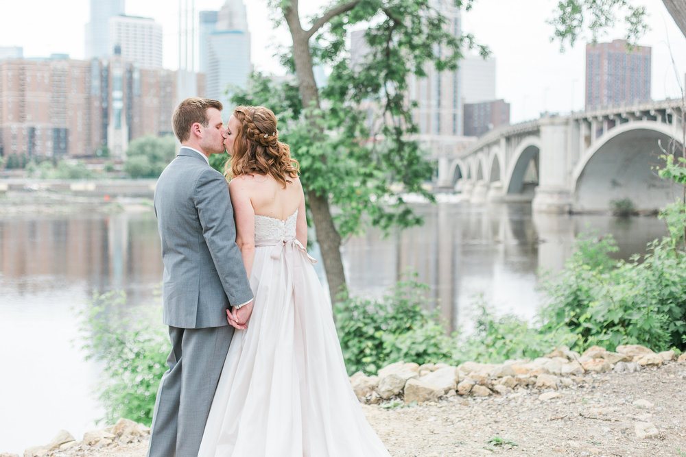 Minneapolis wedding photo with bride and groom along the river