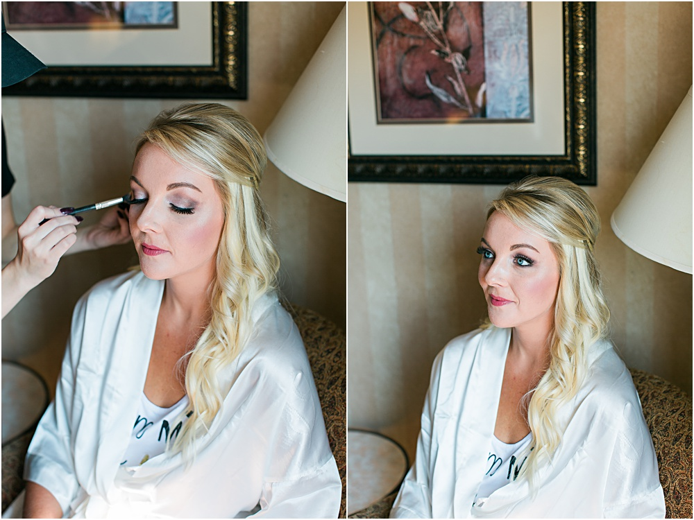 Minnesota summer wedding of bride getting makeup on in bridal robe
