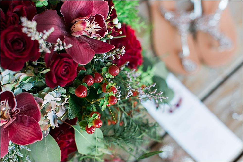 Minnesota summer wedding photo showing burgundy wine red floral bride bouquet