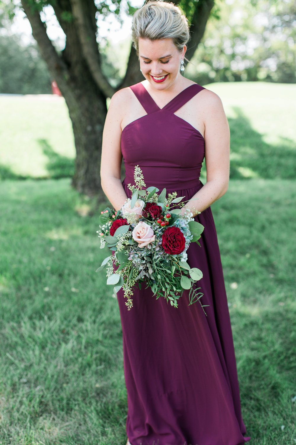Minnesota bridesmaid in burgundy dress with stunning bouquet Minnesota wedding photography Mallory Kiesow Photography