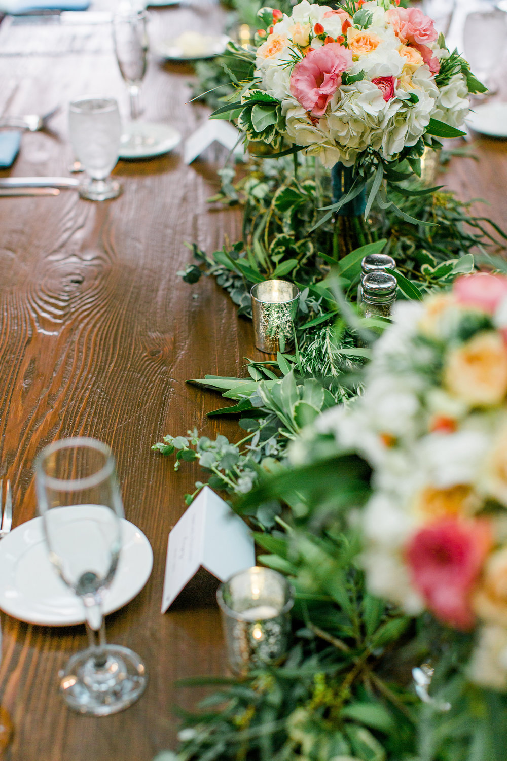 Rustic Minneapolis wedding tablescape with floral garland Minnesota wedding photography Mallory Kiesow Photography