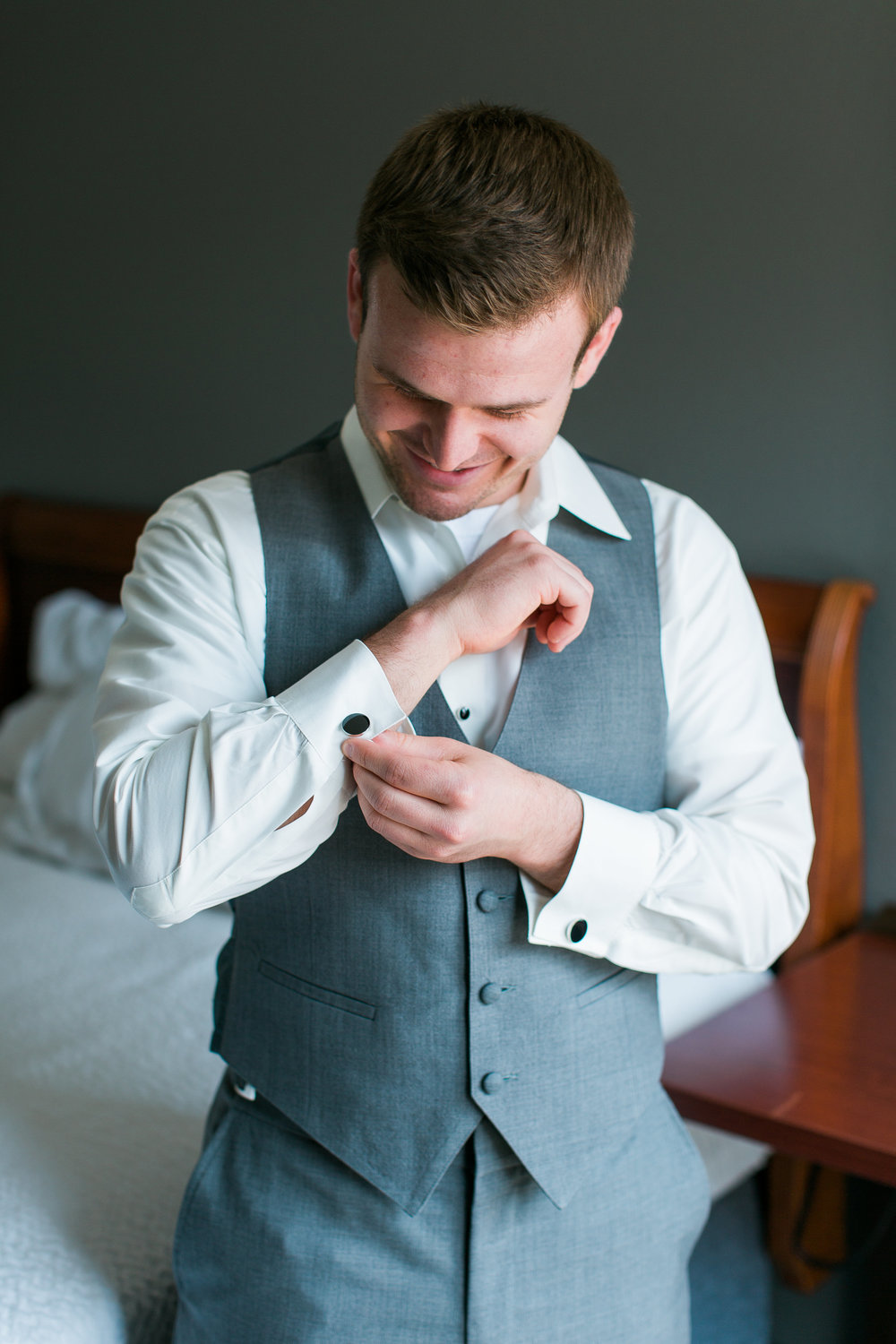 Minneapolis groom doing cufflinks getting ready for wedding Minnesota wedding photography Mallory Kiesow Photography