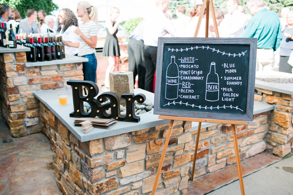 The Outpost Center in Chaska Minnesota rustic outdoor bar setup Minnesota wedding photography Mallory Kiesow Photography