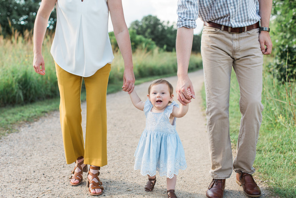 Minnesota family photograph of mom dad and toddler walking hand in hand one year photography Minnesota family photographer Mallory Kiesow Photography