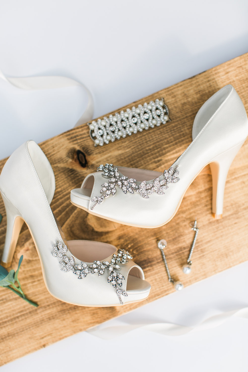 Bride's shoes and jewelry on rustic board bridal styling details Minnesota wedding photography Mallory Kiesow Photography