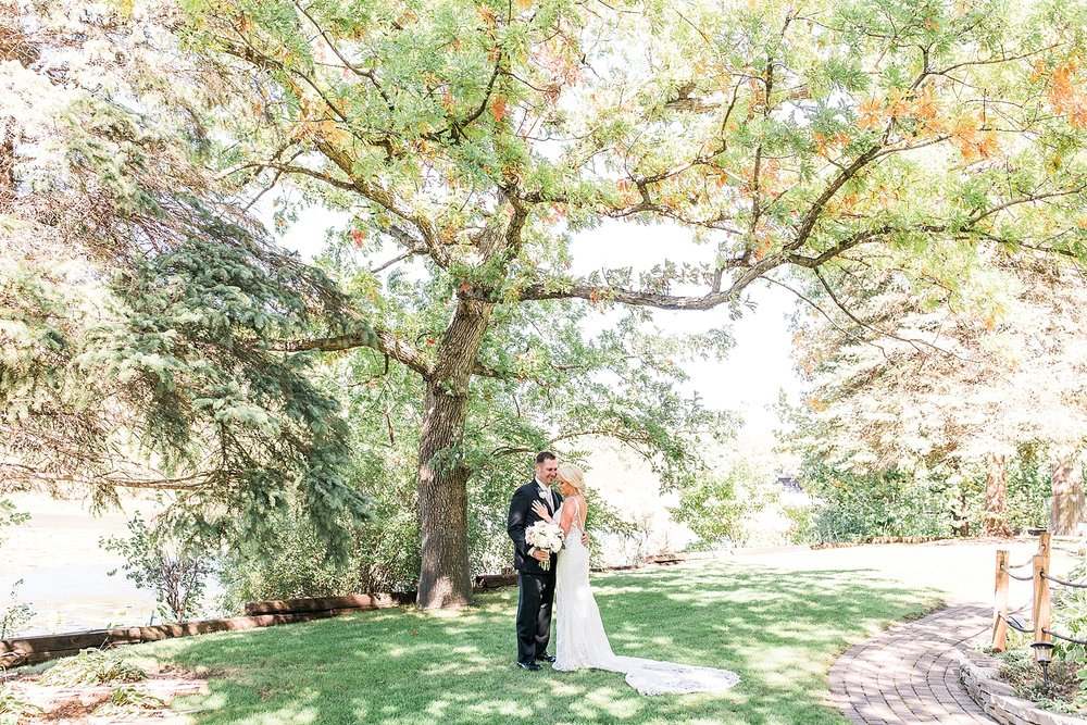 Bride and groom wedding portrait under big tree on wedding day at the Chart House Summer Wedding Lakeville Minnesota Minneapolis Wedding Photographer Mallory Kiesow