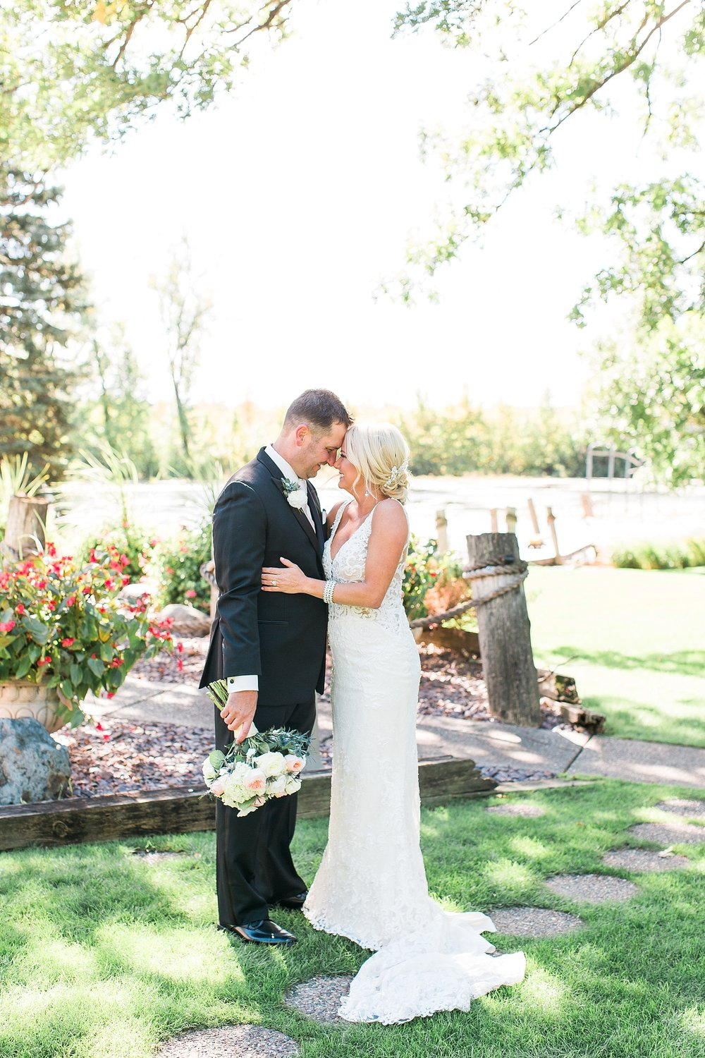 Bride and groom wedding portrait on wedding day at the Chart House Summer Wedding Lakeville Minnesota Minneapolis Wedding Photographer Mallory Kiesow