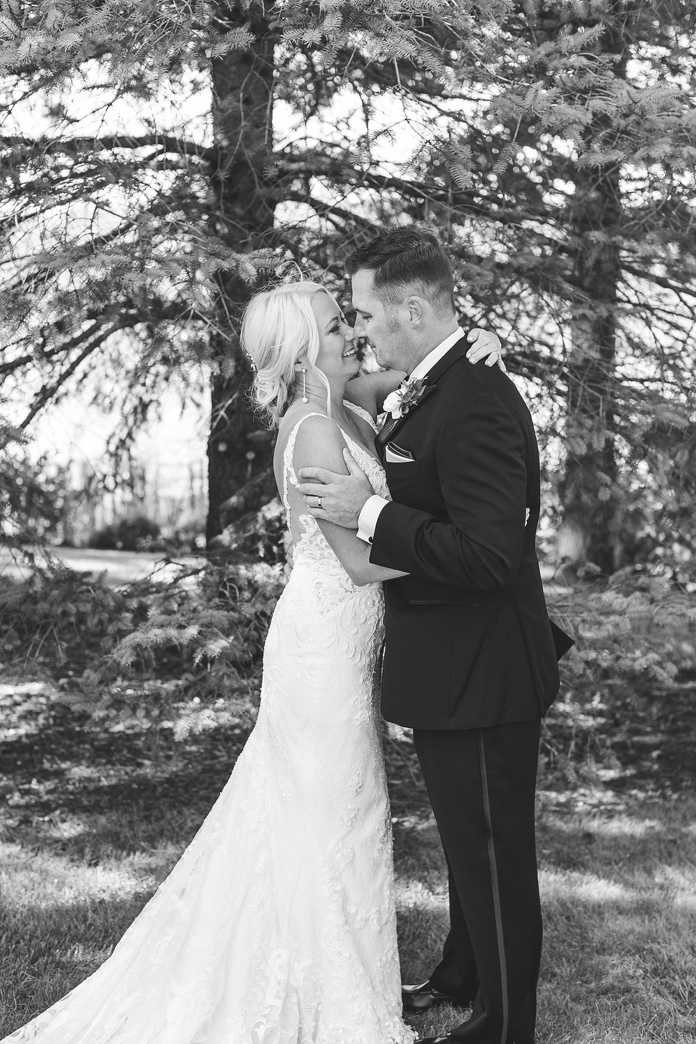 Bride and groom black and white wedding portraits on wedding day at the Chart House Summer Wedding Lakeville Minnesota Minneapolis Wedding Photographer Mallory Kiesow