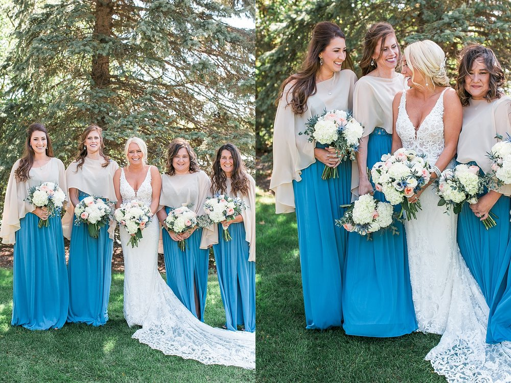 Bride and bridesmaids in blue dresses on wedding day at the Chart House Summer Wedding Lakeville Minnesota Minneapolis Wedding Photographer Mallory Kiesow