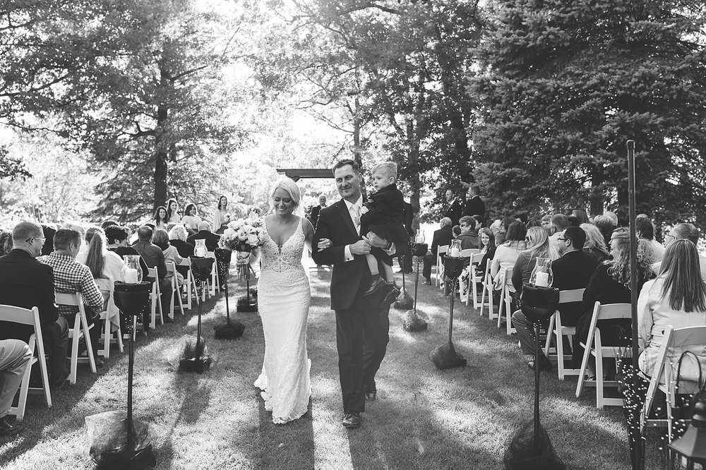 Outdoor wedding ceremony celebratory exit at the Chart House Summer Wedding Lakeville Minnesota Minneapolis Wedding Photographer Mallory Kiesow