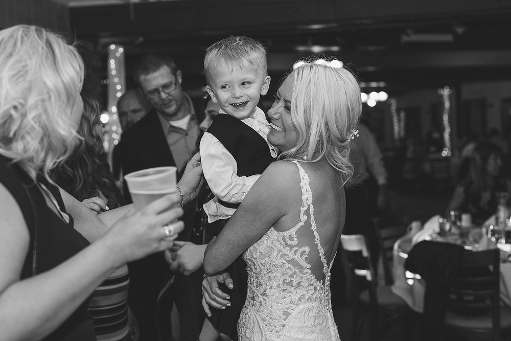 Bride and son candid at the Chart House Summer Wedding Lakeville Minnesota Minneapolis Wedding Photographer Mallory Kiesow