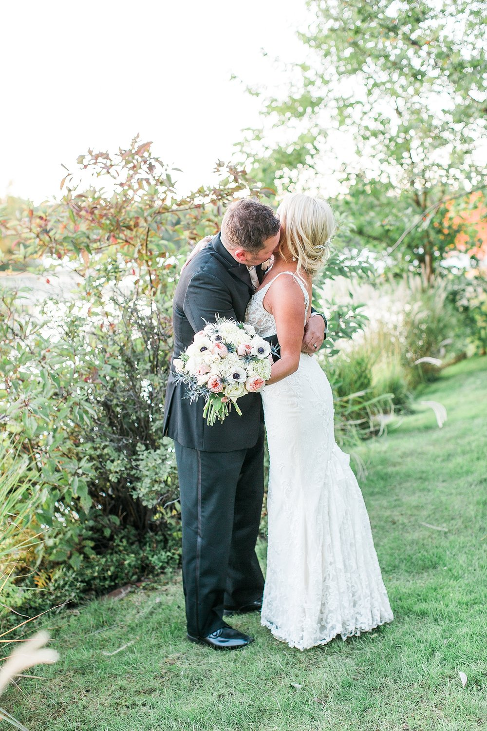 Bride and groom sunset golden hour portrait embrace at the Chart House Summer Wedding Lakeville Minnesota Minneapolis Wedding Photographer Mallory Kiesow