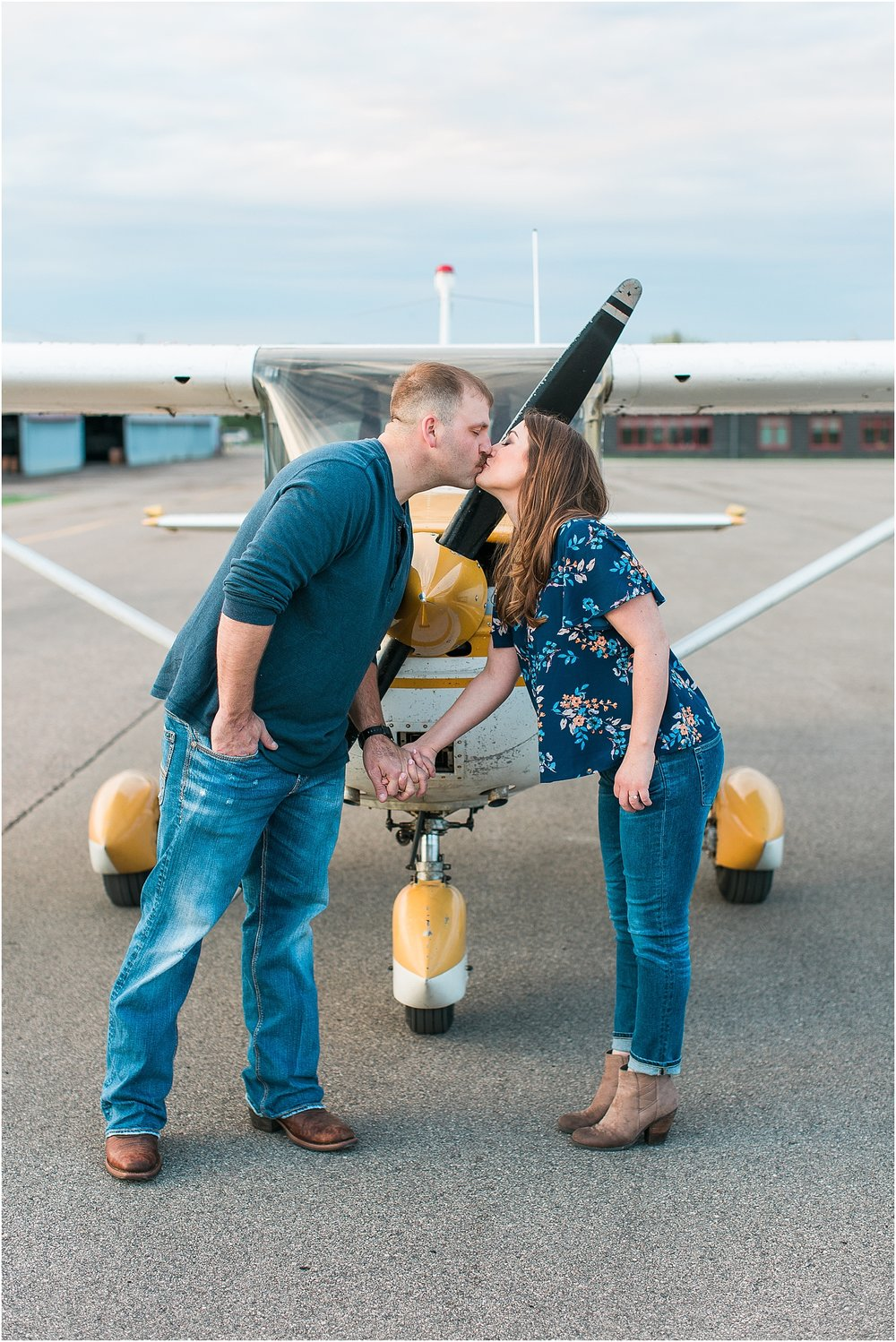 Minneapolis airplane engagement photography session at flying cloud airport in Eden Prairie photographed by Mallory Kiesow Minneapolis engagement and wedding photographer_9.jpg