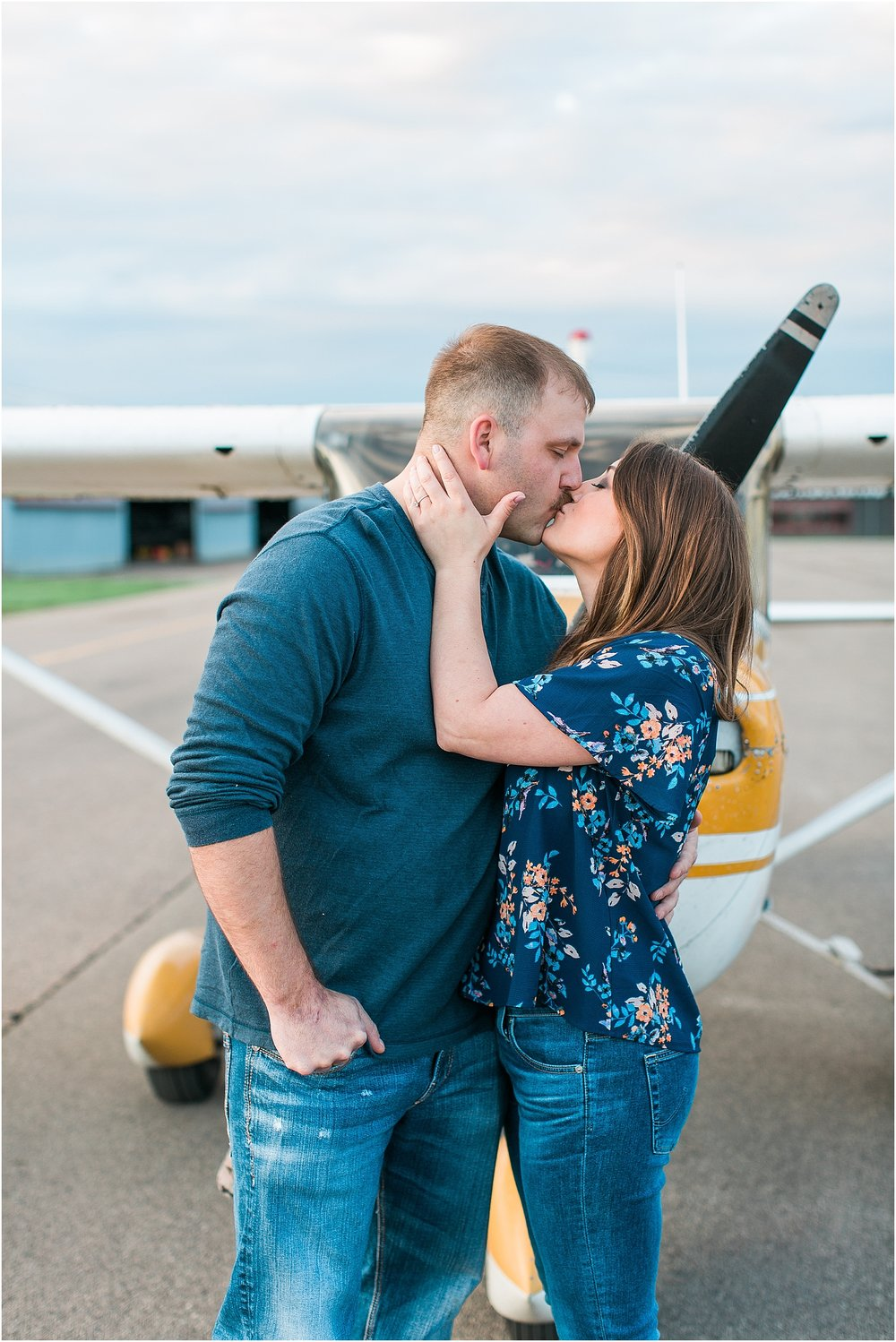 Minneapolis airplane engagement photography session at flying cloud airport in Eden Prairie photographed by Mallory Kiesow Minneapolis engagement and wedding photographer_11.jpg