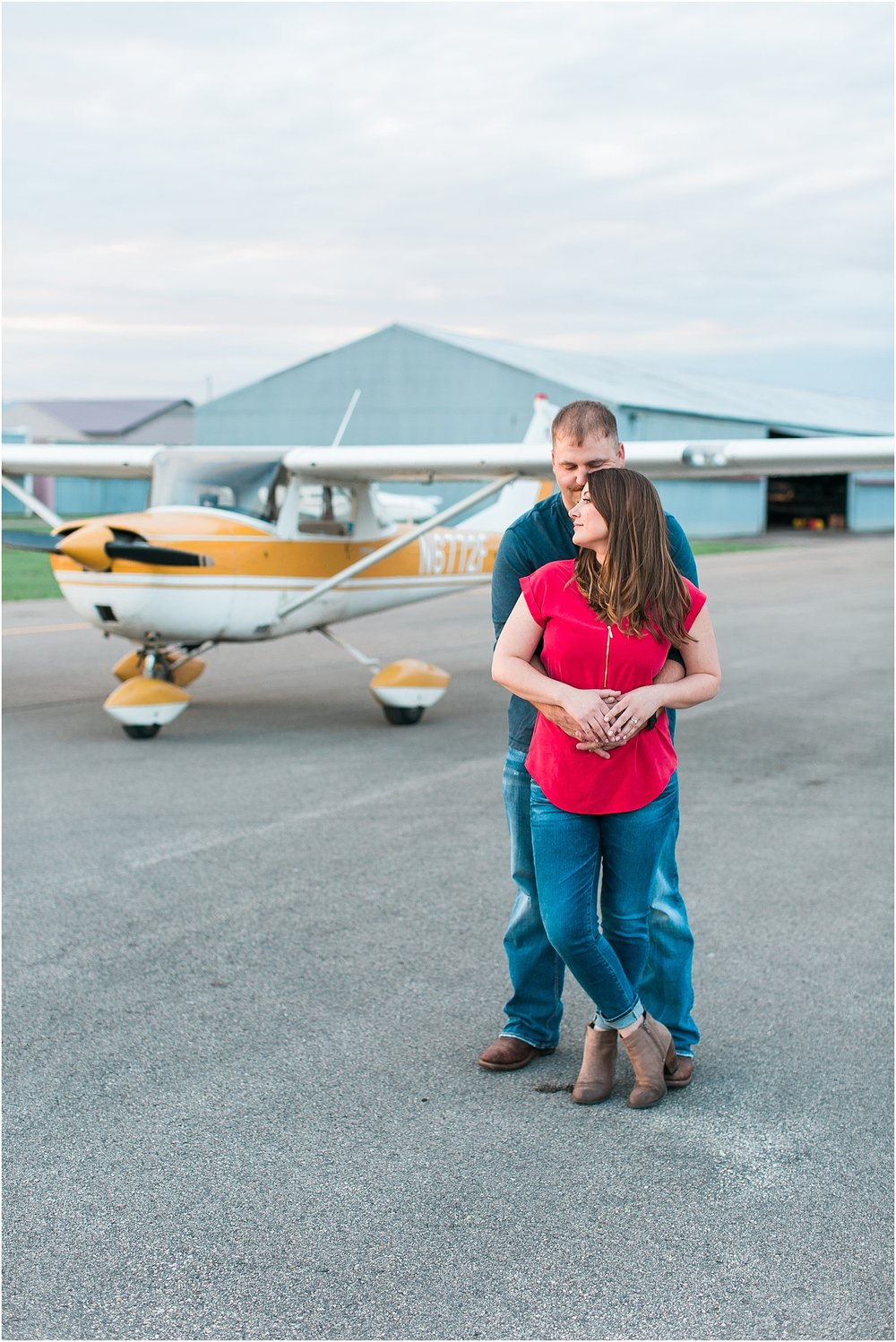 Minneapolis airplane engagement photography session at flying cloud airport in Eden Prairie photographed by Mallory Kiesow Minneapolis engagement and wedding photographer_15.jpg