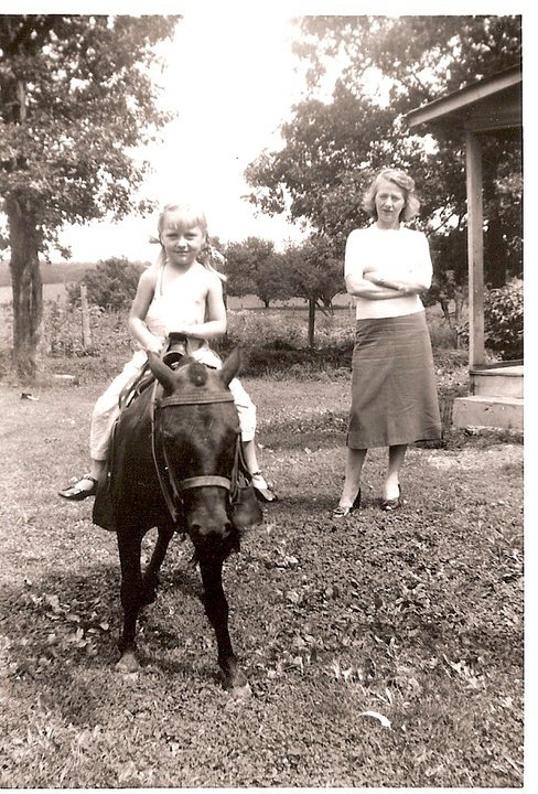 Here, I see my Grandmother as a darling little girl, being watched by her own Mother.