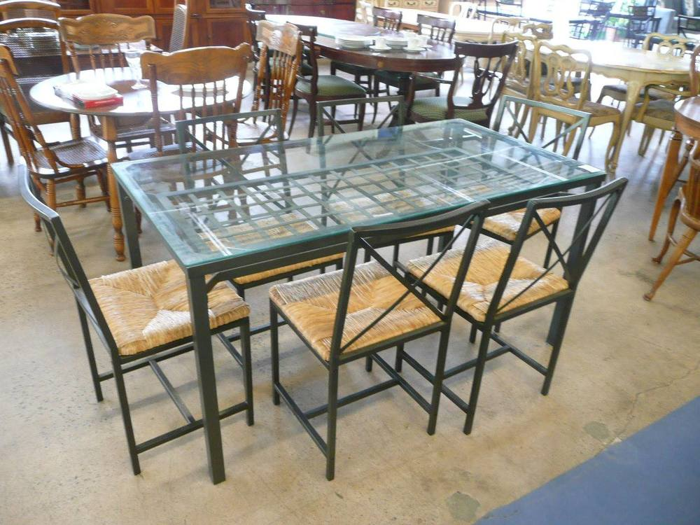 Glass and wrought iron dining room table with chairs