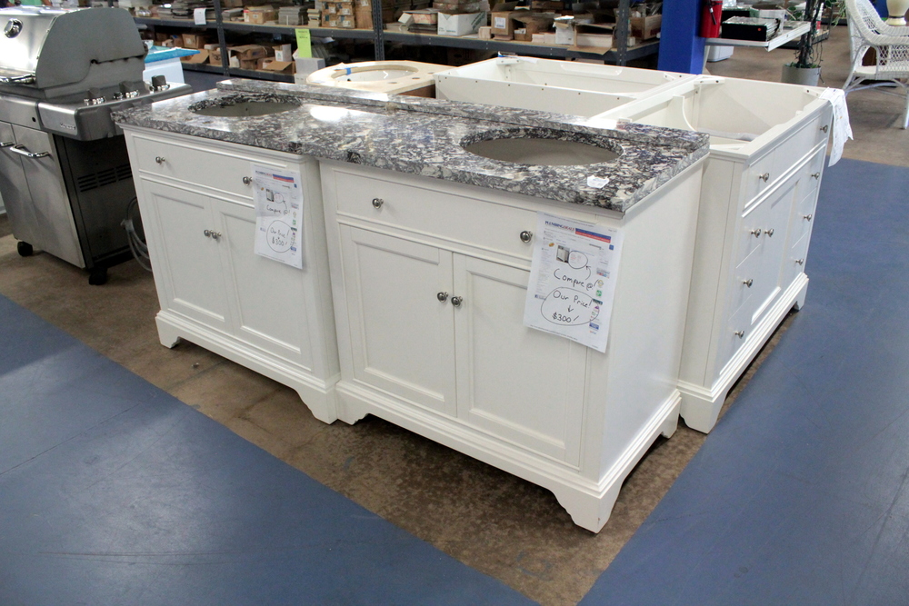 SOLD! White and Granite Double Sink Vanity for only $300. We are looking for items like this!  Donate today!