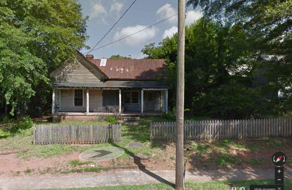 Buildingoriginally builtin the 1800s. The future home of The Thirsty Owl.
