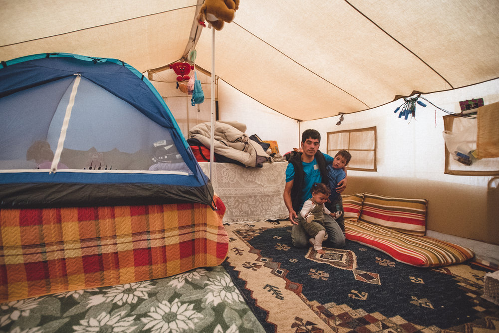 We enter the tent—the smaller tent was to help keep a bit more warmth in. Zarena, Adil, and Setaush would sleep inside, Tamim would sleep on the floor outside so there'd be room. In later visits, the camping tent was taken down.