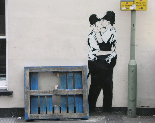 "Banksy, ""Kissing Coppers"" (2004). Image credit: Flavorwire."