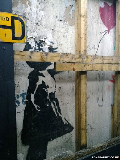 Banksy, Girl and Balloon (2002). Partially covered by building owner.