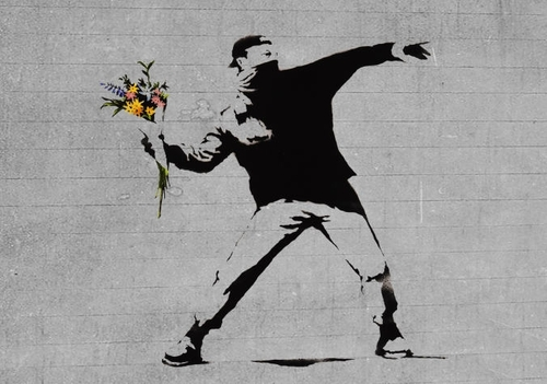 "Banksy, ""Flower Thrower."" Image credit: Popular Resistance."